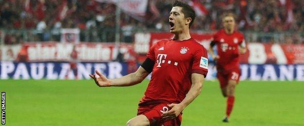Lewandowski celebrates the second of his five goals