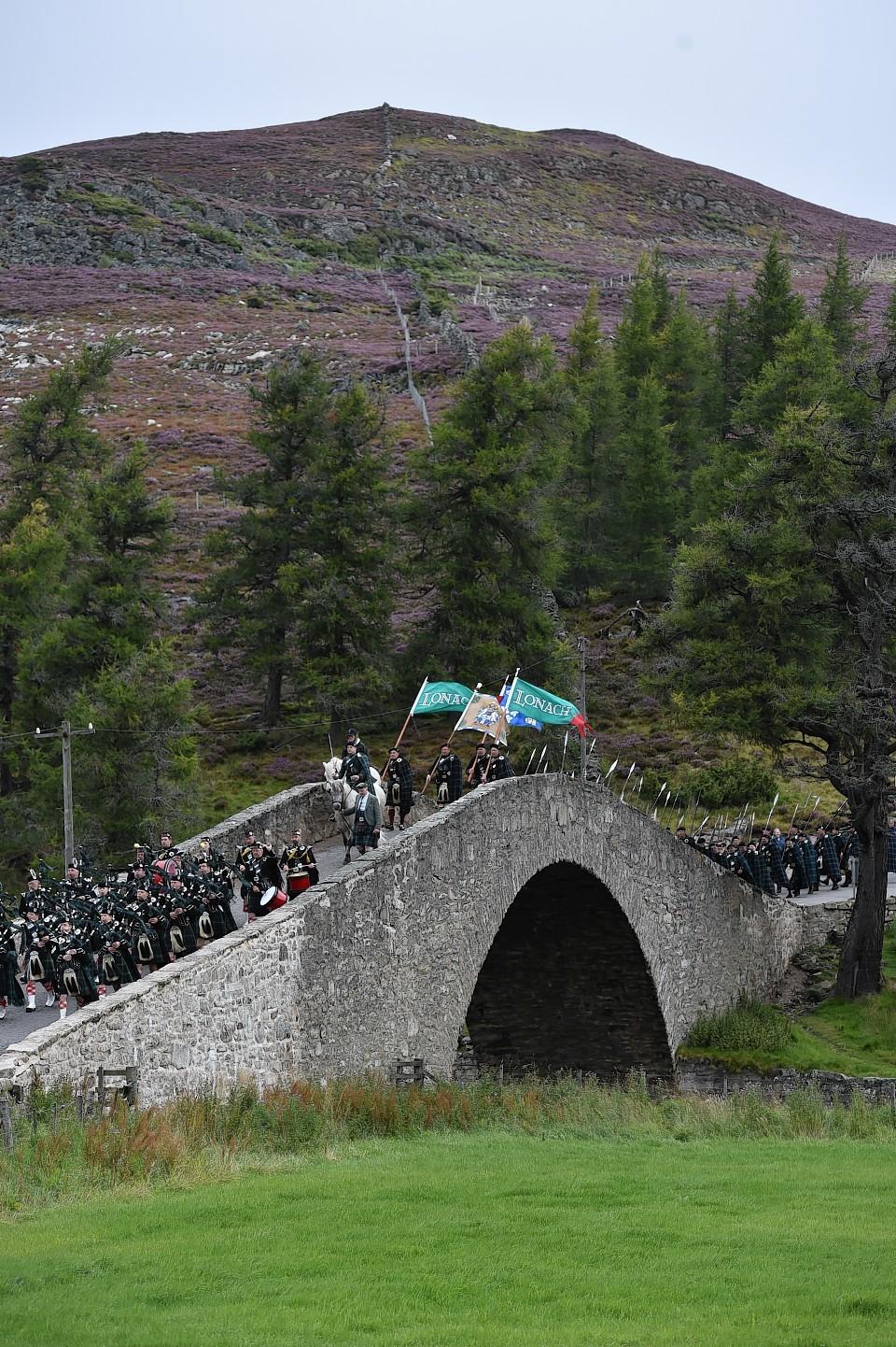 Lonach Highlnaders pass across the historic Gairnshiel Bridge. Picture: Colin Rennie.