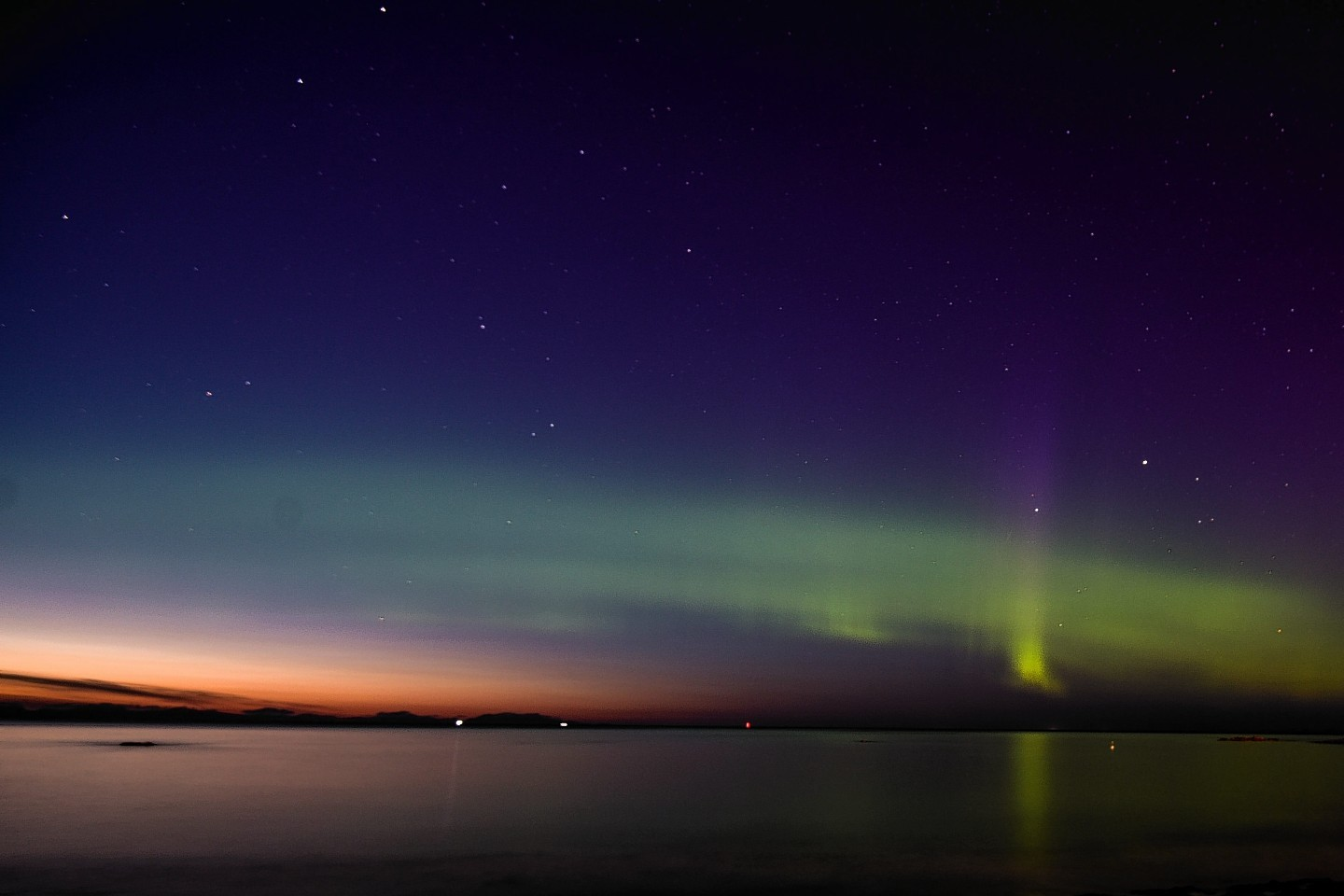 The Aurora Borealis, also known as the Northern Lights, are seen lighting up the sea by the West Beach in Lossiemouth, Moray