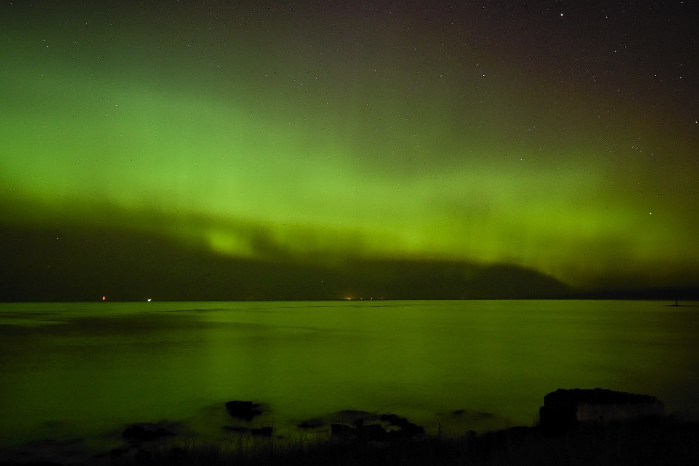 The Aurora Borealis, also known as the Northern Lights, are seen lighting up the sea by Lossiemouth