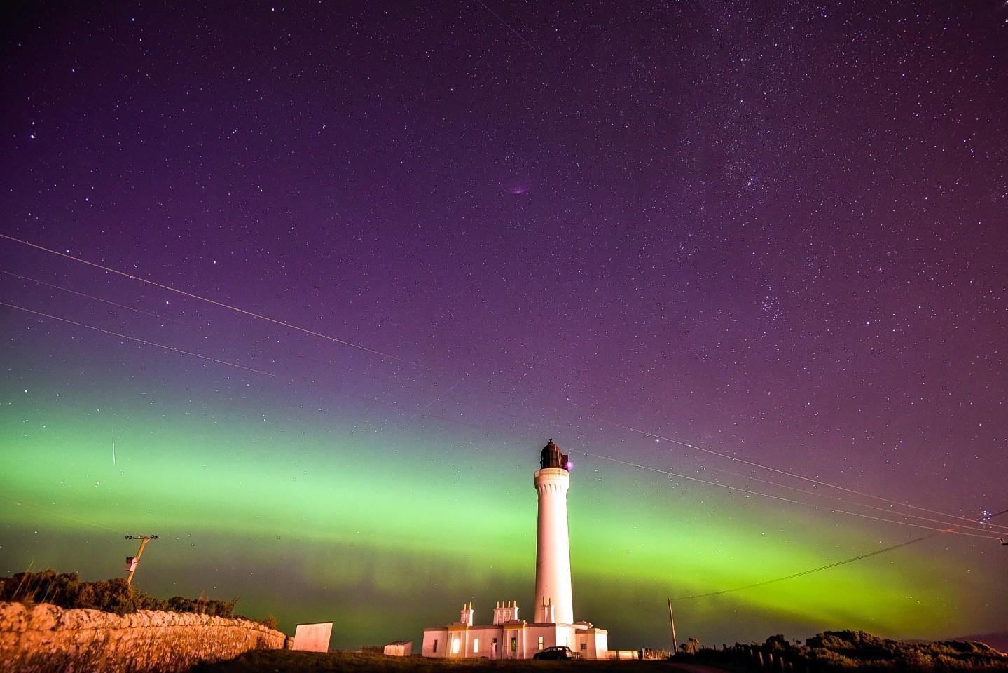 Covesea Lighthouse near Lossiemouth, Moray is set against the Aurora Borealis,
