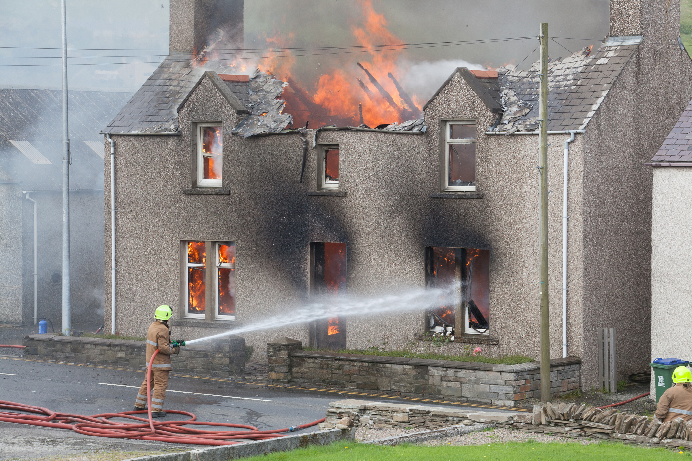 Fire units from both Stromness and Kirkwall tackle the house blaze in the village of Finstown. Pic Orkney photographic