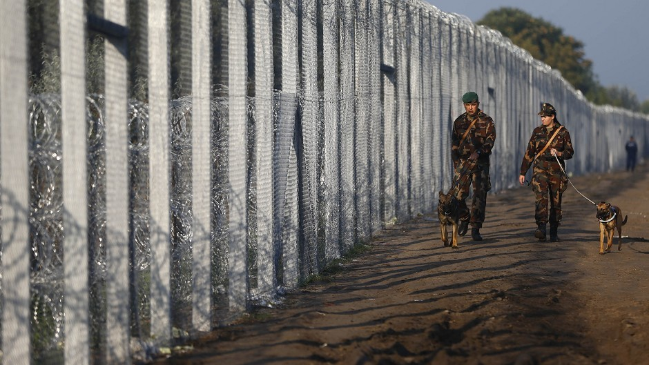 Hungarian soldiers patrol the border line with Serbia