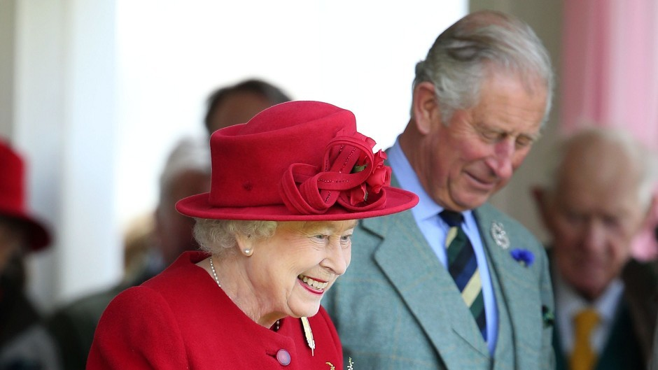 The Queen and the Prince of Wales attend the Braemar games
