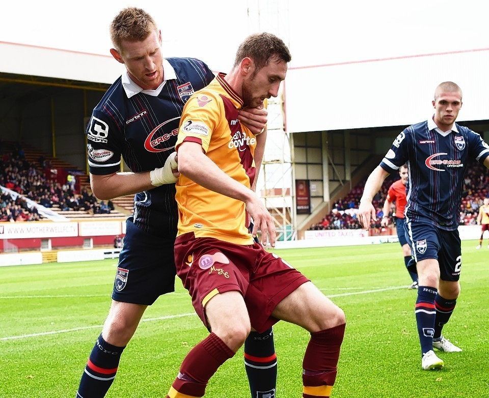 Chris Robertson challenges Motherwell's Louis Moult on Saturday