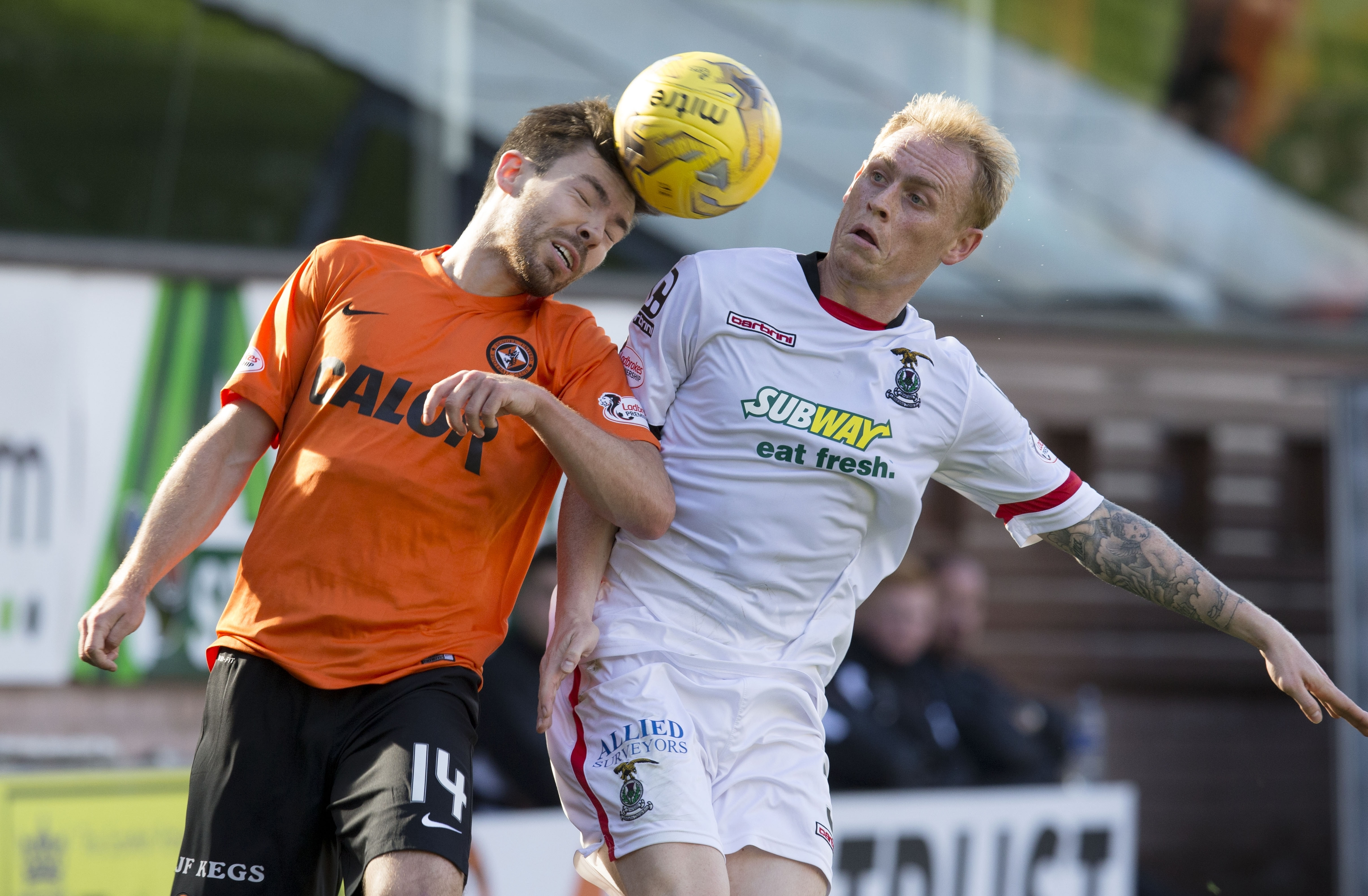 Carl Tremarco competes with Dundee United midfielder Ryan Dow