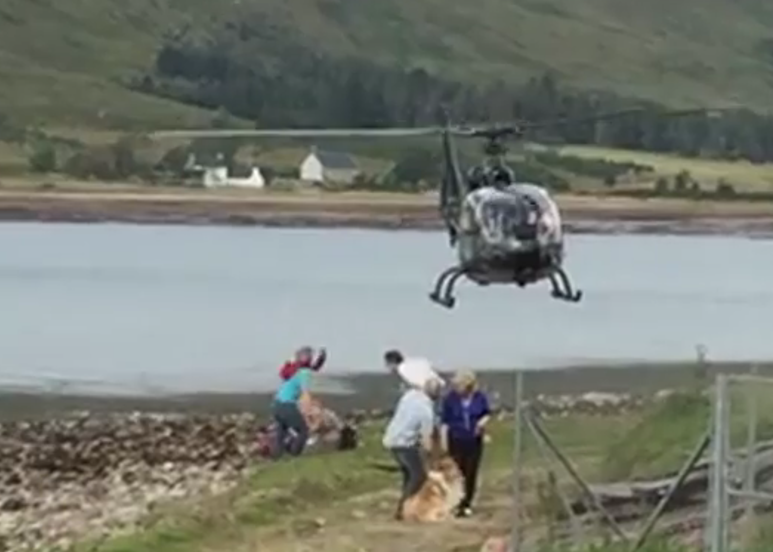 Picnickers flee as the helicopter comes in to land