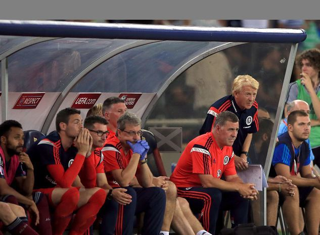 Strachan with his defeated team