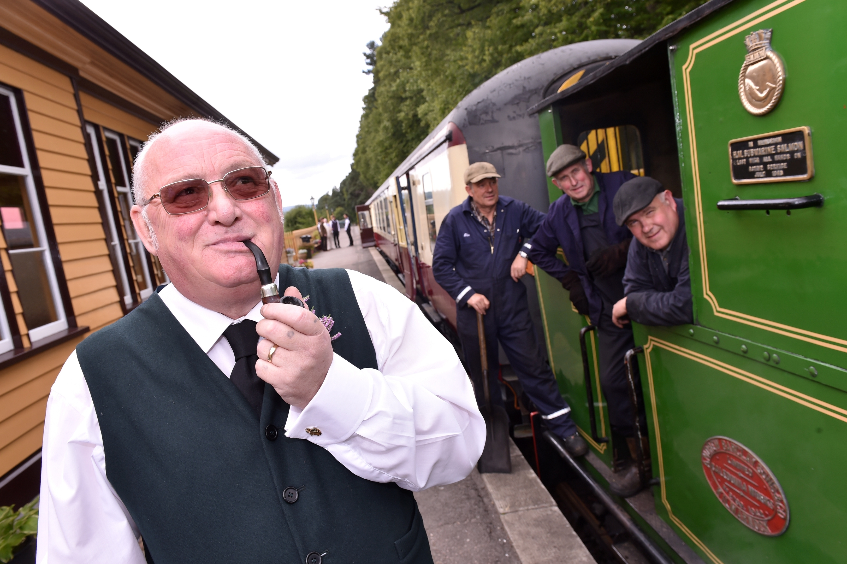 Milton of Crathes Station - the wedding of Shaun Allan and Carol McLaughlin had taken place on the moving carriage. David Pearson, membership secretary at Crathes with engineers. Picture by COLIN RENNIE  September 10, 2015.