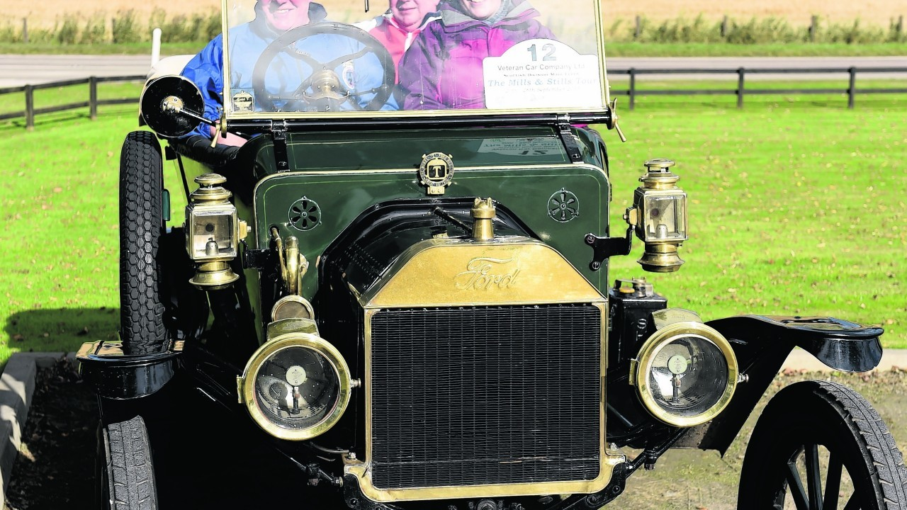 Les Coull, Anna Corry and David Corry, rear, in the 1913 Ford Model T, at Speyside Cooperage, Cragellachie.
