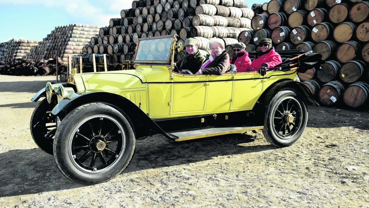 One of the cars from Germany,  a 1913 Chalmers type 36, beside the casks at Speyside Cooperage.