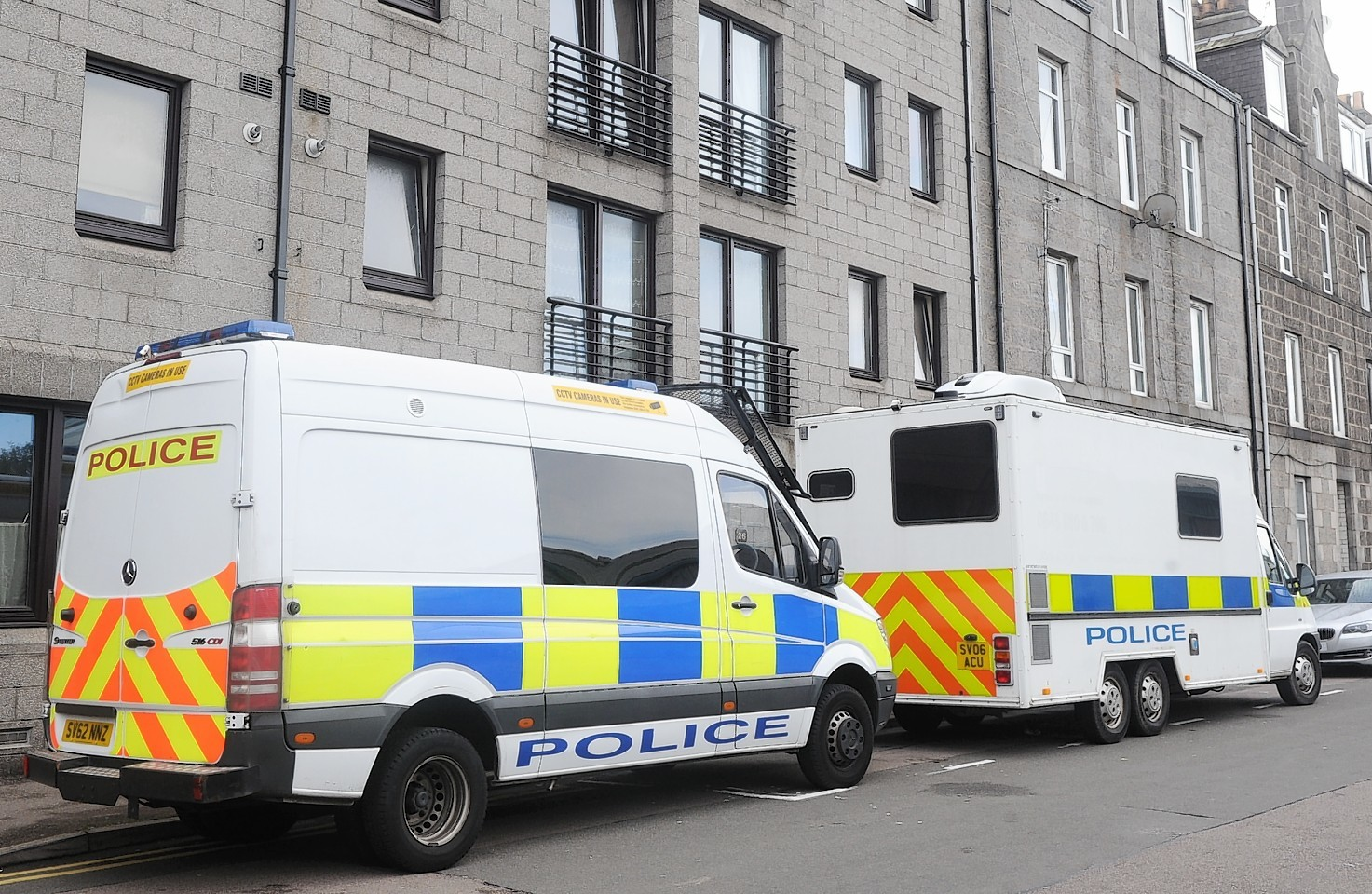 Police outside the Hollan Street flat where James Chadwick was murdered in September last year