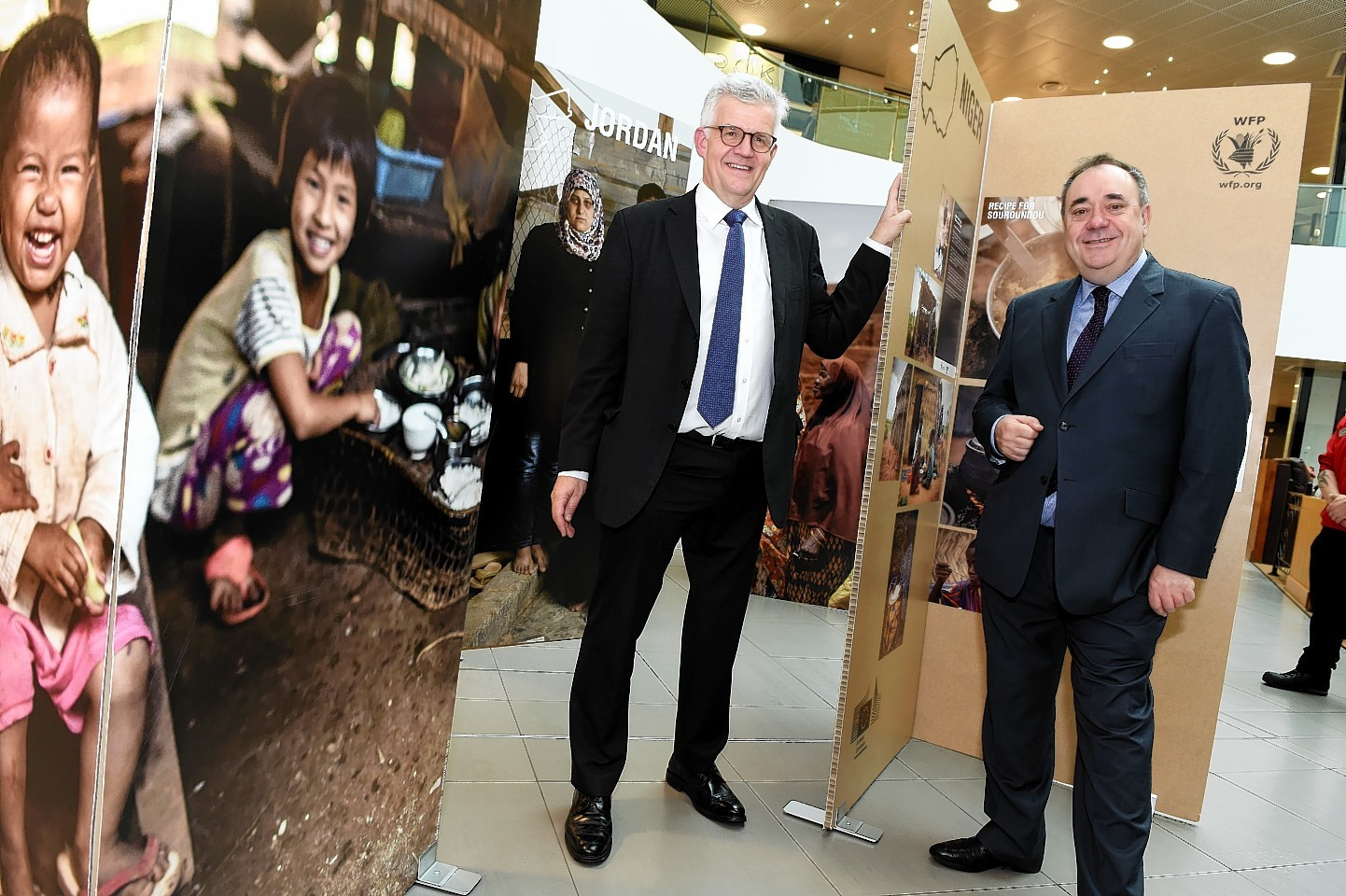 Graham Blythe, Head of the Office of the European Commission in Scotland and Alex Salmond MP at The Family Meal – What Brings Us Together? photo exhibition held at The Bon Accord shopping centre, Aberdeen.