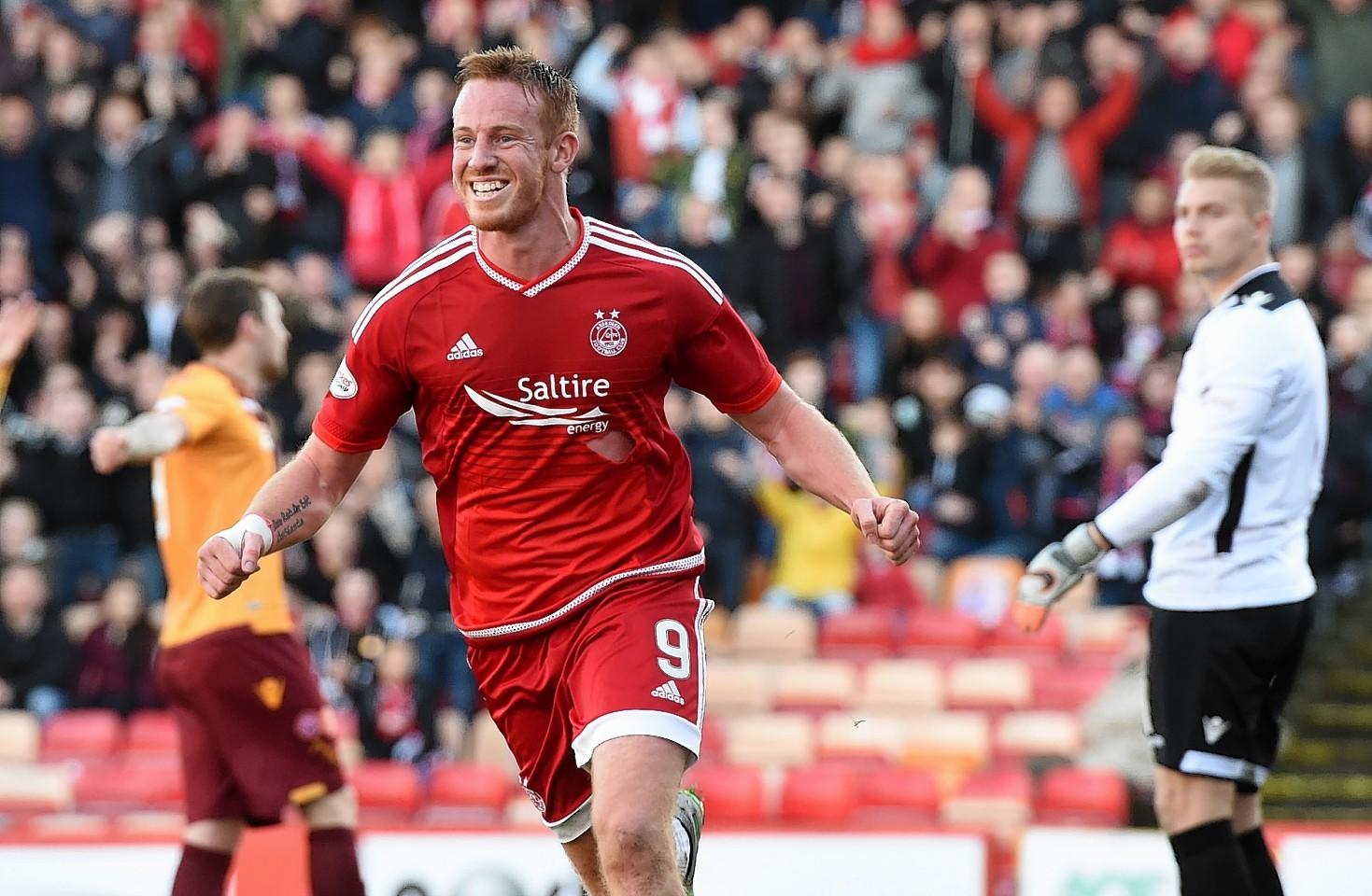 Adam Rooney celebrates opening the goalscoring for Aberdeen