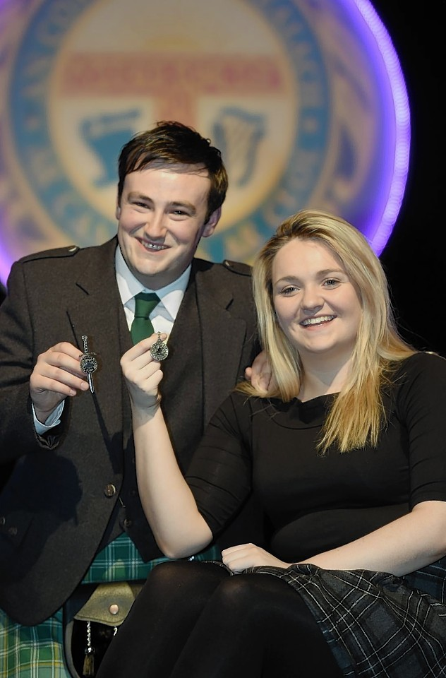 Alasdair Currie of Islay and Kirsty Watt of Stornoway with their Silver Pendants