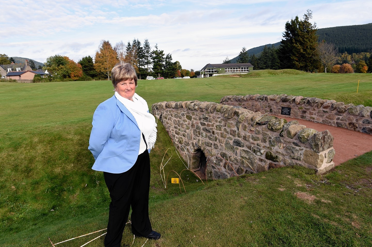 Ballater Golf Club ladies captain, Sandie Barns, beside the new bridge at the 18th hole to mark 100 years since the first women began playing on their greens.