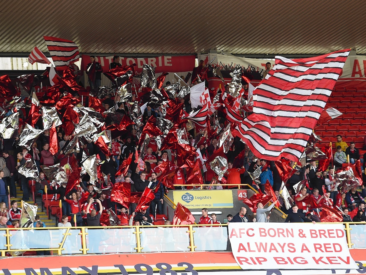 Fans display a banner in memory of football coach and Aberdeen fan Kevin Bartlet