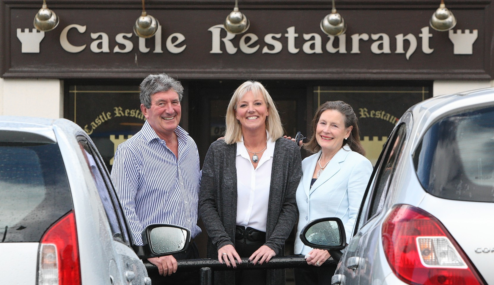 Katie MacKinnon, middle, new owner of the Castle Restaurant in Inverness, with previous owners Christine and Brian Lipton.