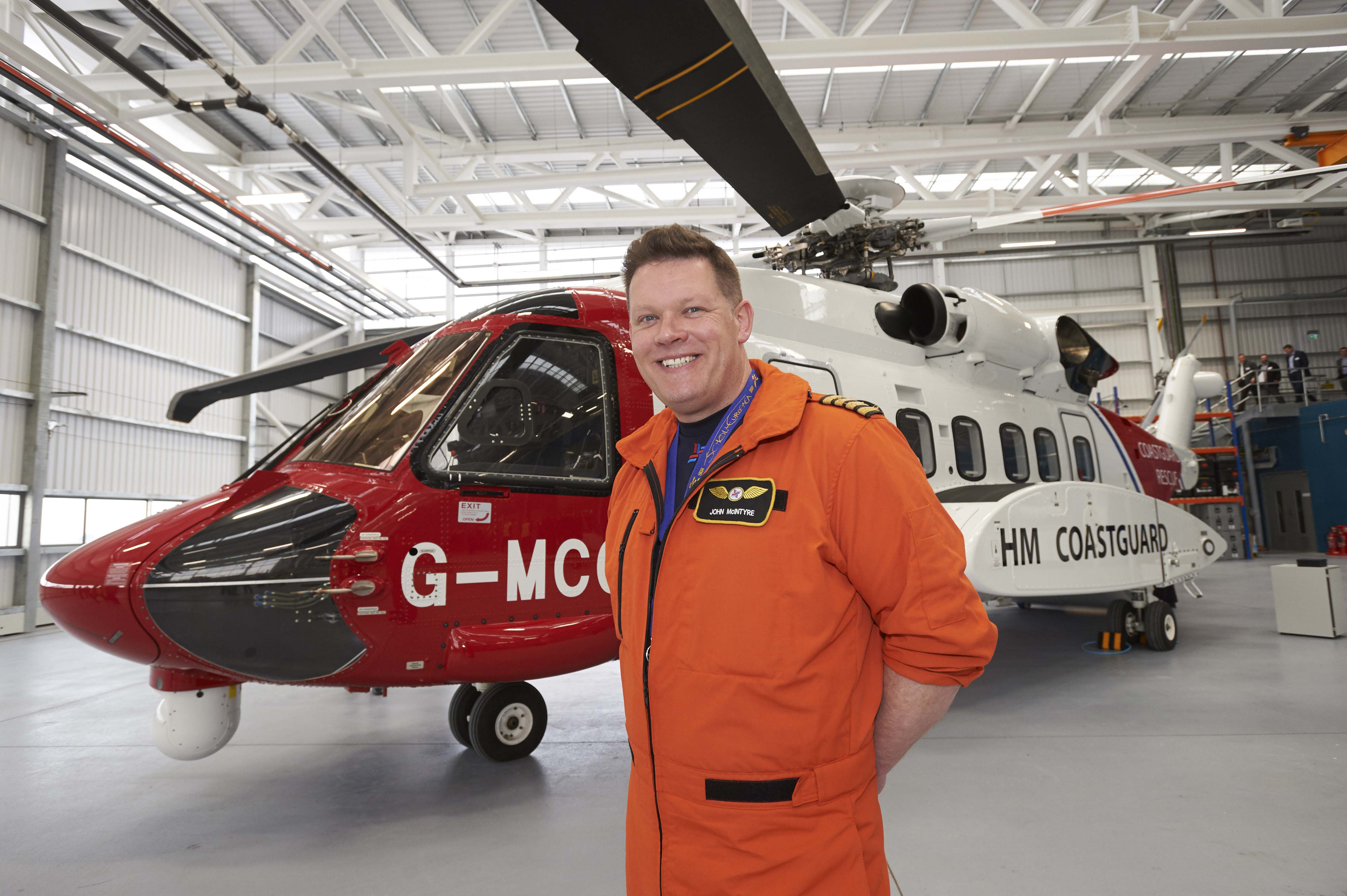 Chief Pilot Captain John McIntyre beside the  Sikorsky S92 helicopter