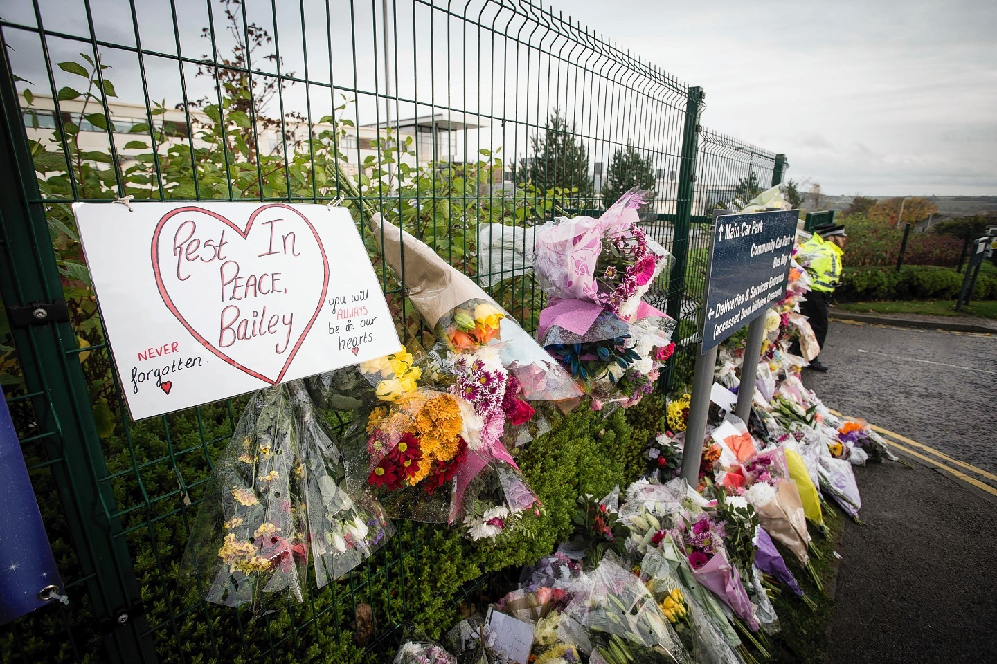 The collection of tributes to Bailey outside the school continues to grow
