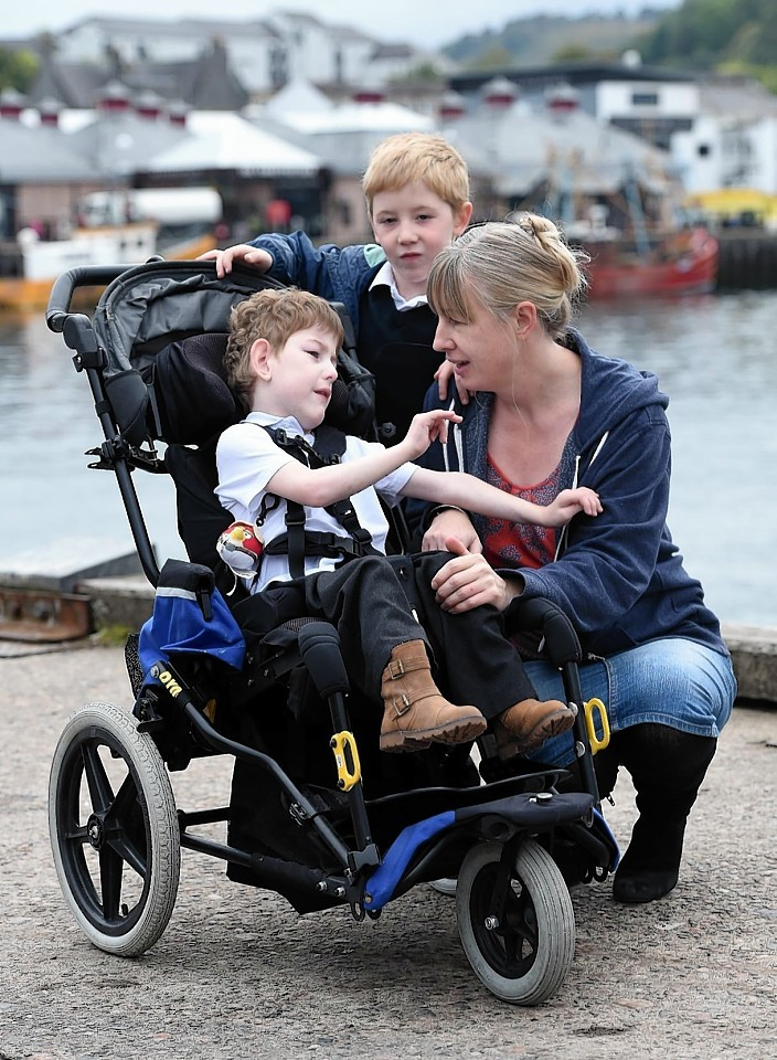 Oban mum Sandra Bruce with her two disabled children Callan and Finlay (5) seated who will suffer with the withdrawl of services.