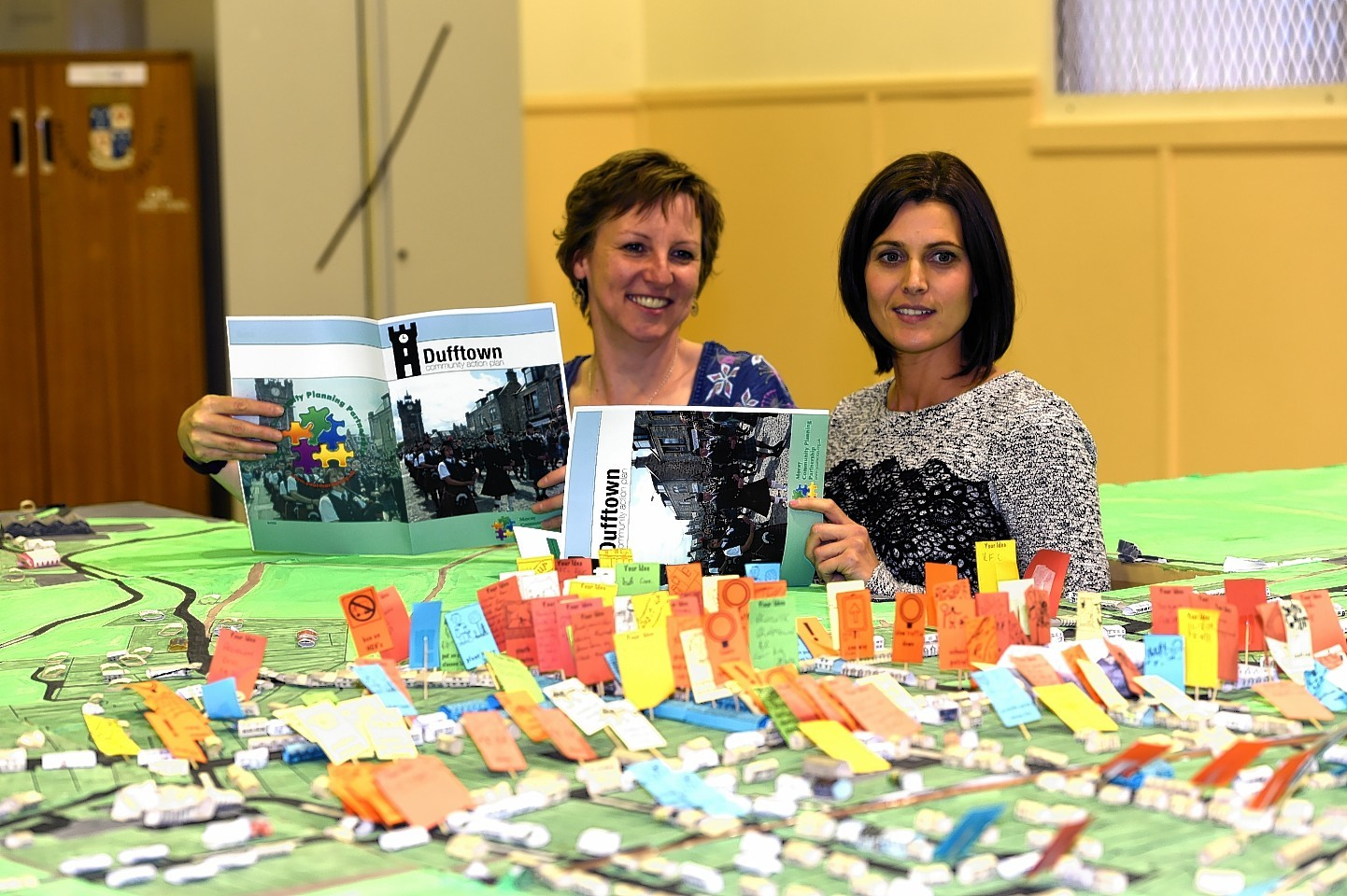 Eleanor Candy, left, and Nicky Alexander, right, pictured with the Action Plan and a 3d map of Dufftown. Picture by Gordon Lennox