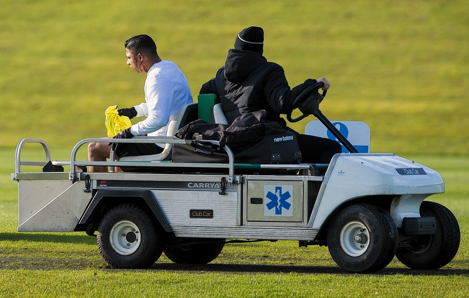 Celtic's Emilio Izaguirre is driven away from the training field after the incident with Nadir Ciftci