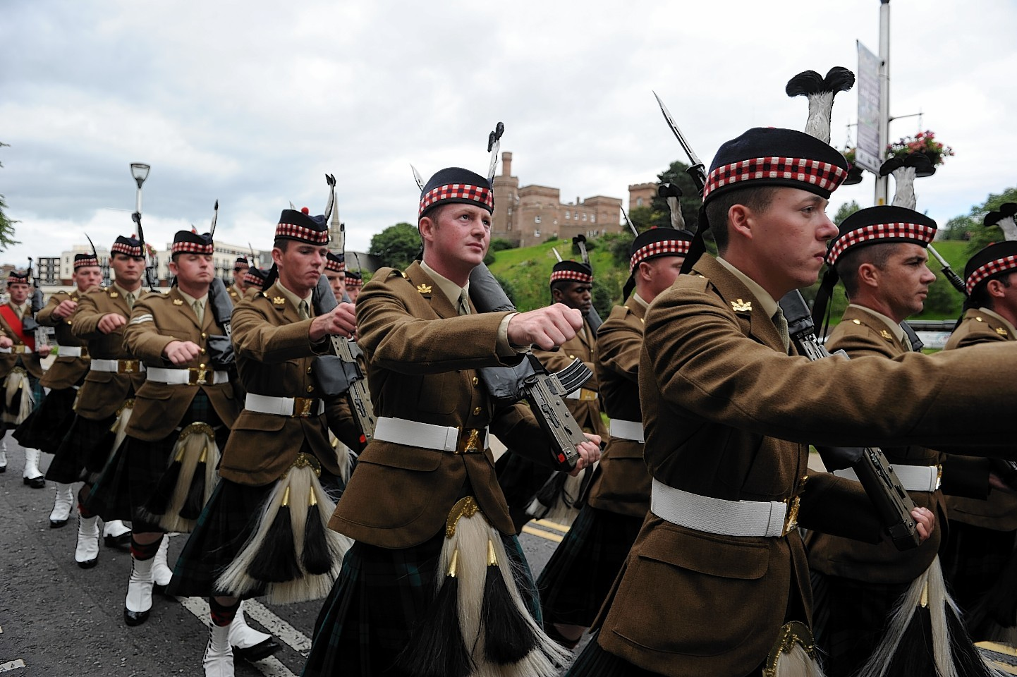 The Highlanders as they marched through Inverness in June 2014
