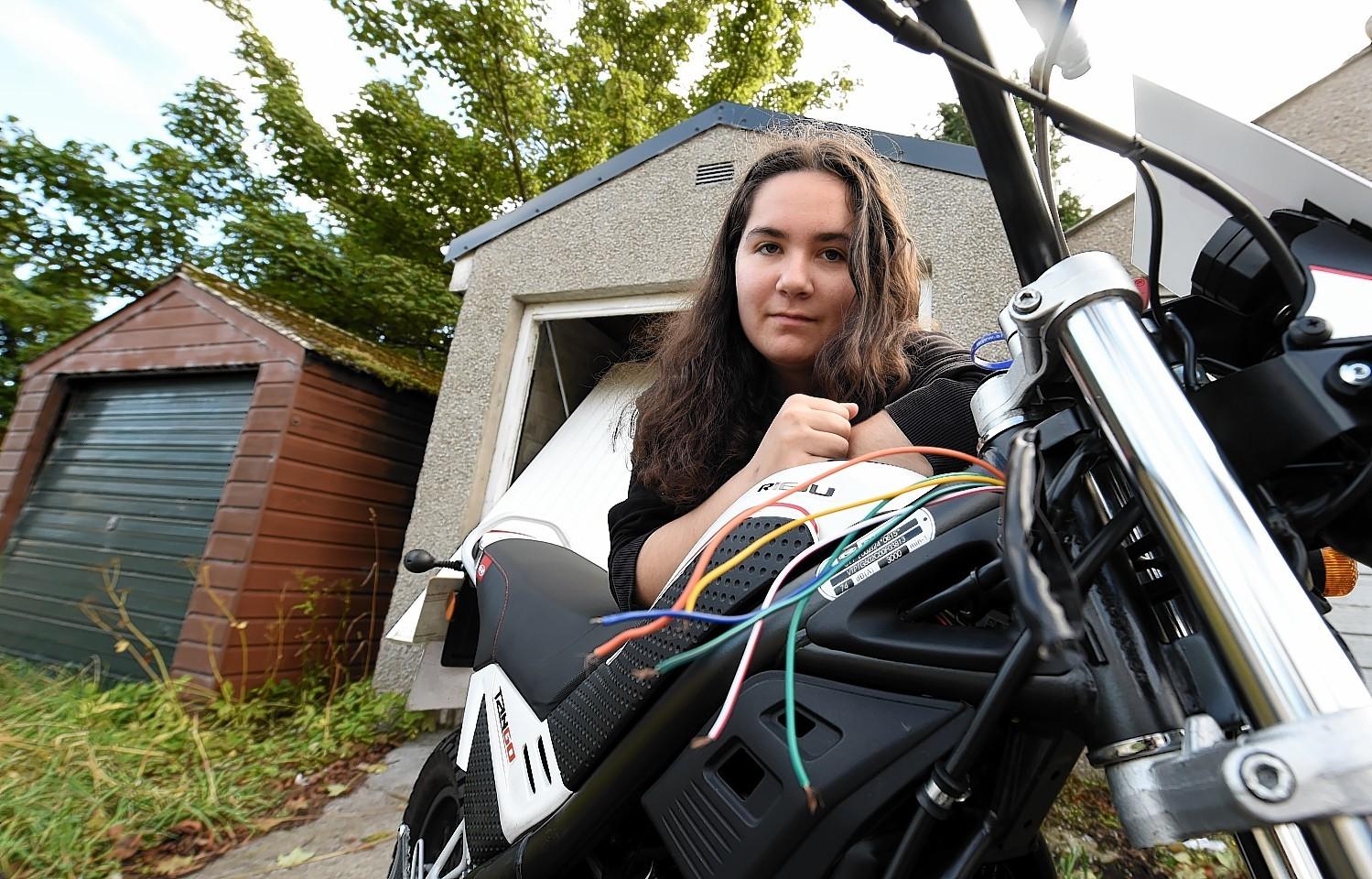 Jackalynn Walker, Bucksburn, Aberdeen, happy to get her stolen bike back.  Picture by JIM IRVINE  13-9-15