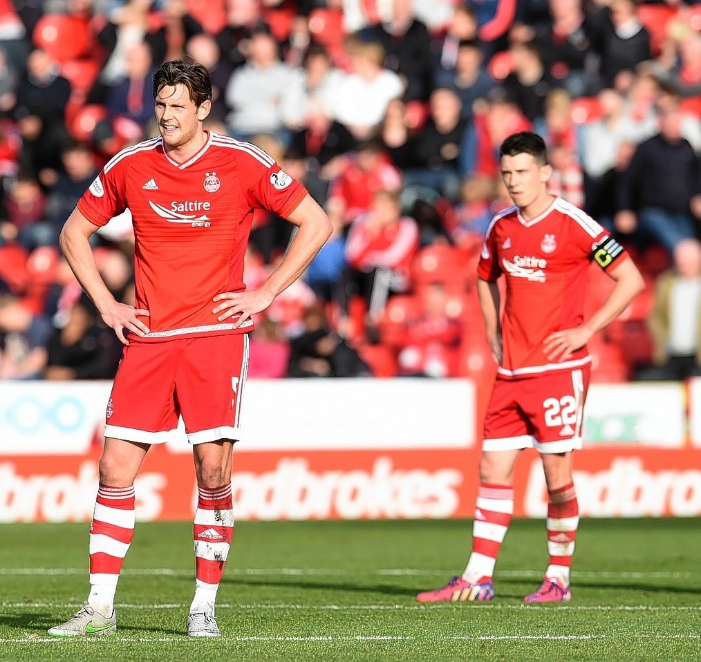 Aberdeen's Ash Taylor (left) and Ryan Jack stand dejected amid the Dons slump