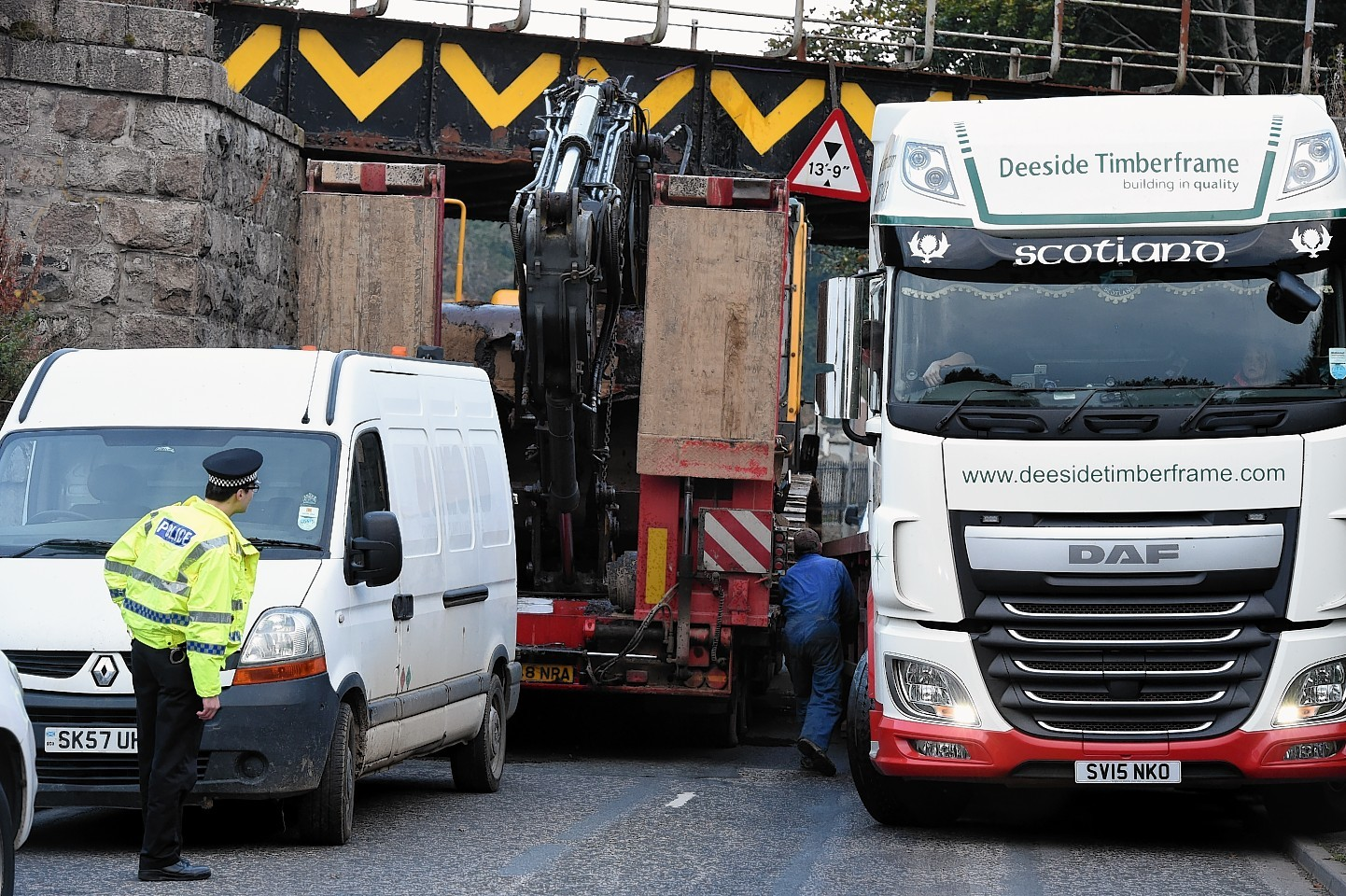 A lorry, left, gets stuck on the B993 Keithhall road at Port Elphinstone, Inverurie