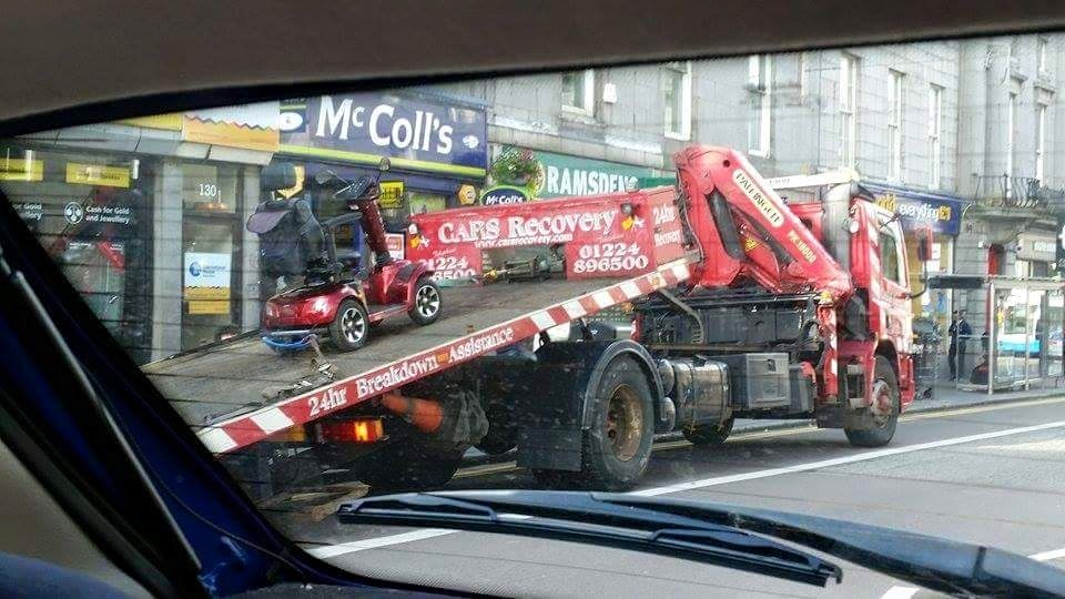 Massive recovery truck rescues pensioner's mobility scooter