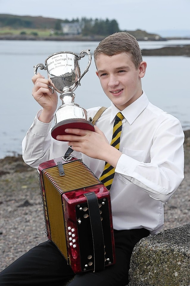 Duncan Shirkie of Lewis with the Hebrides Haulage Trophy