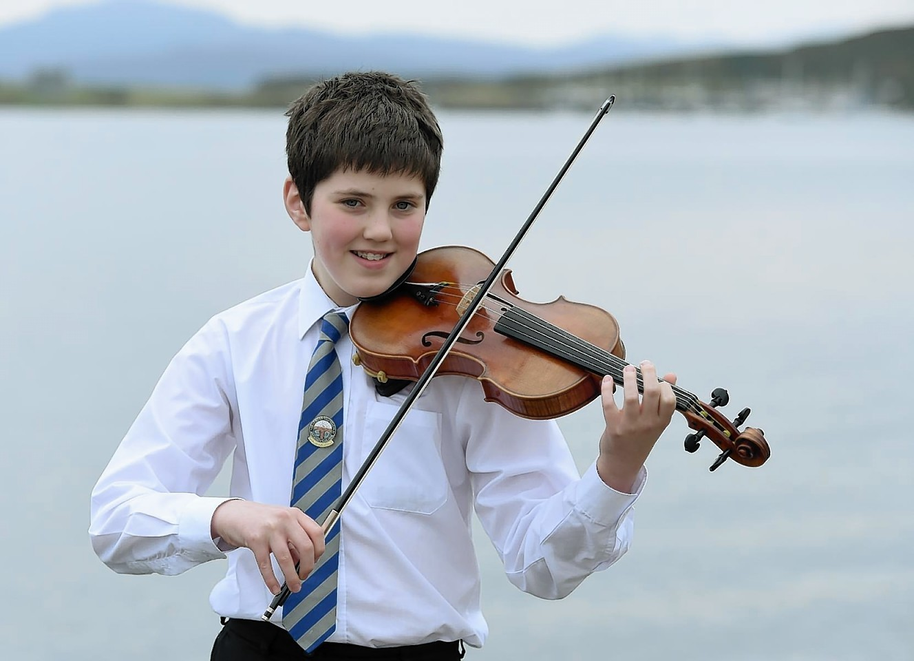 Lachlan Kennedy of Edinburgh but whose family are from Lewis and Inverness with his Gold Medal for Fiddle music
