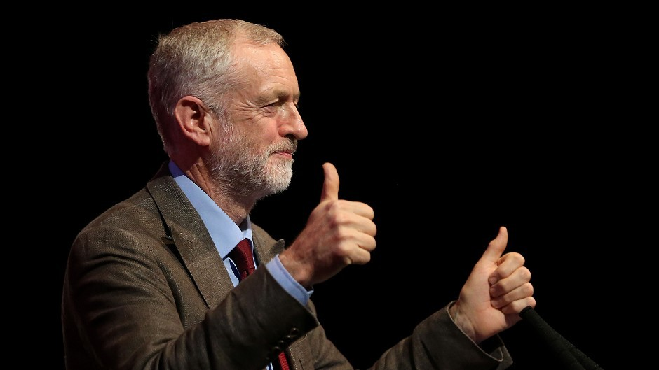 Labour leader Jeremy Corbyn gives a thumbs-up during his speech at Perth Concert Hall on the first day of the Scottish Labour conference