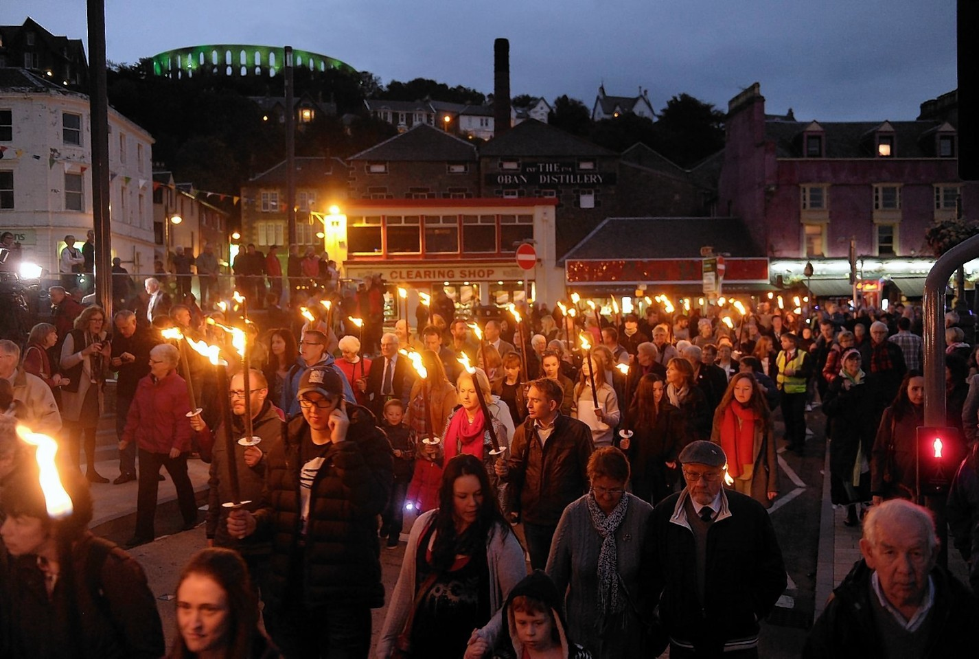 The openning torch light procession of the Royal National Mod makes its way through the streets of Oban