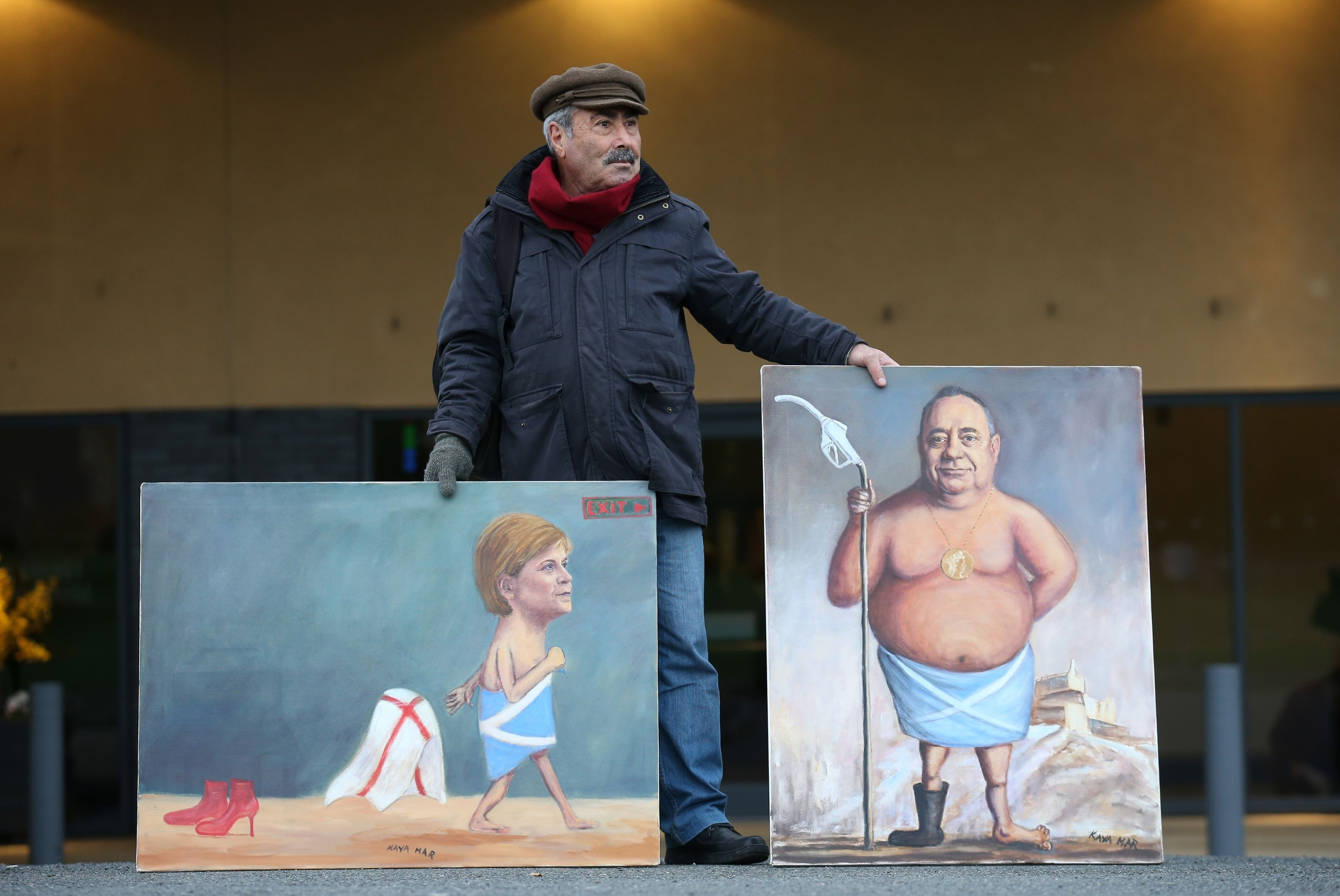 Satirical artist Kaya Mar with his paintings of SNP leader Nicola Sturgeon and SNP MP Alex Salmond outside the SNP National Conference at the Aberdeen Exhibition and Conference Centre.