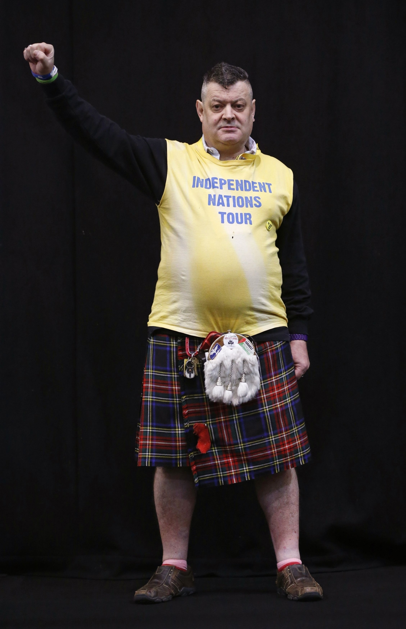 SNP supporter Steve Davie poses for a photograph