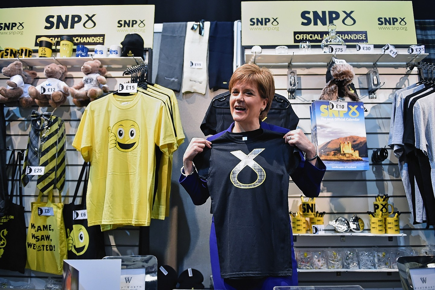 First Minister of Scotland and SNP leader Nicola Sturgeon visits a stall on day two of the 81st annual conference at the Aberdeen Exhibition and Conference Centre  in October 2015