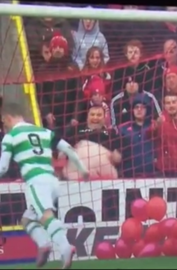 This stalwart Dons fan tips the scales of fair play during a Celtic game