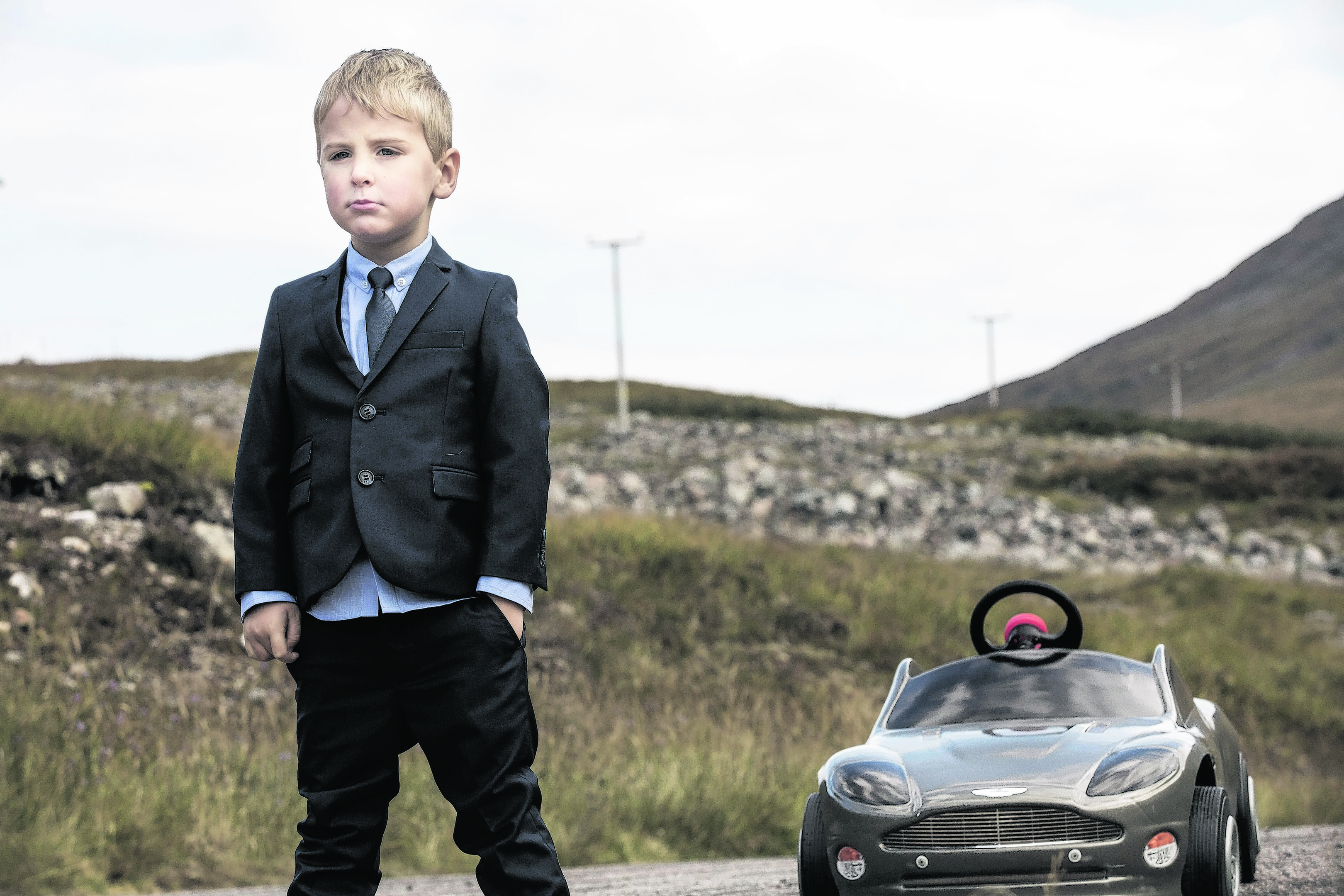 Young Mikey Bell recreates a scene from Skyfall on a  visit to Glen Etive in the Highlands.  Photo: James Glossop for VisitScotland