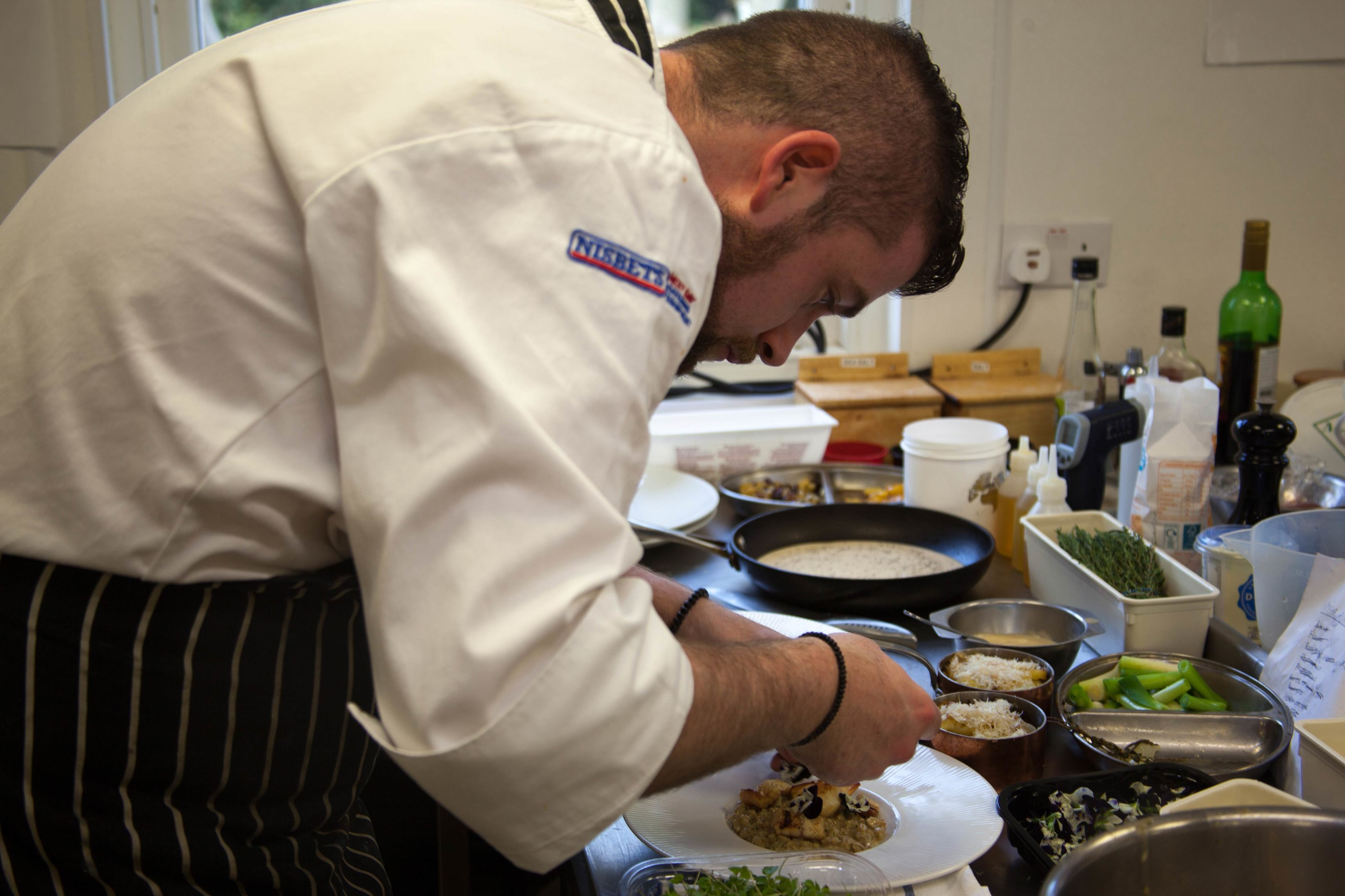 Young Highland Chef David MacDonald puts the finishing touches to his dish