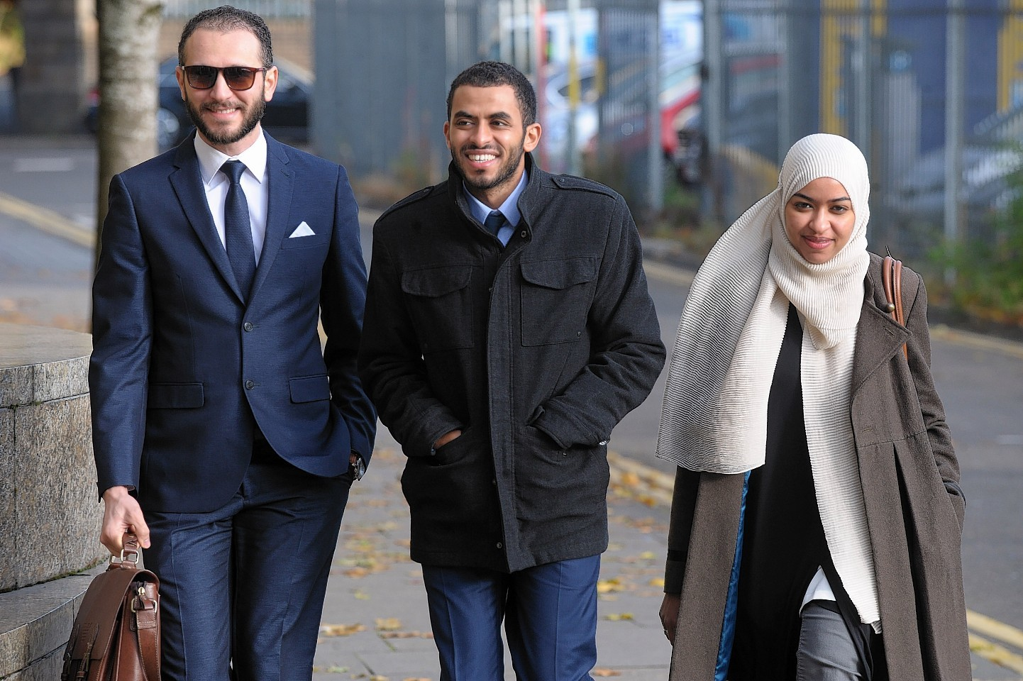 Yousif Baldri ( centre) arriving at the High Court Glasgow