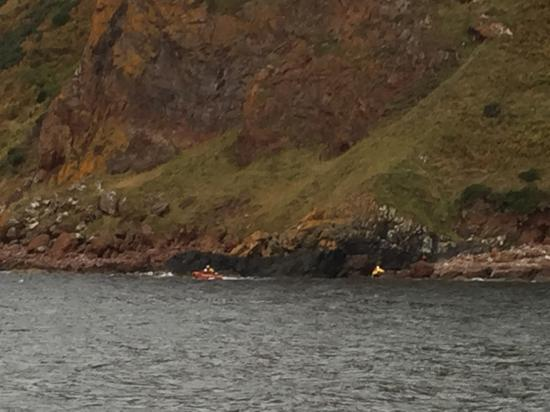 The two women are rescued by a lifeboat crew from Invergordon