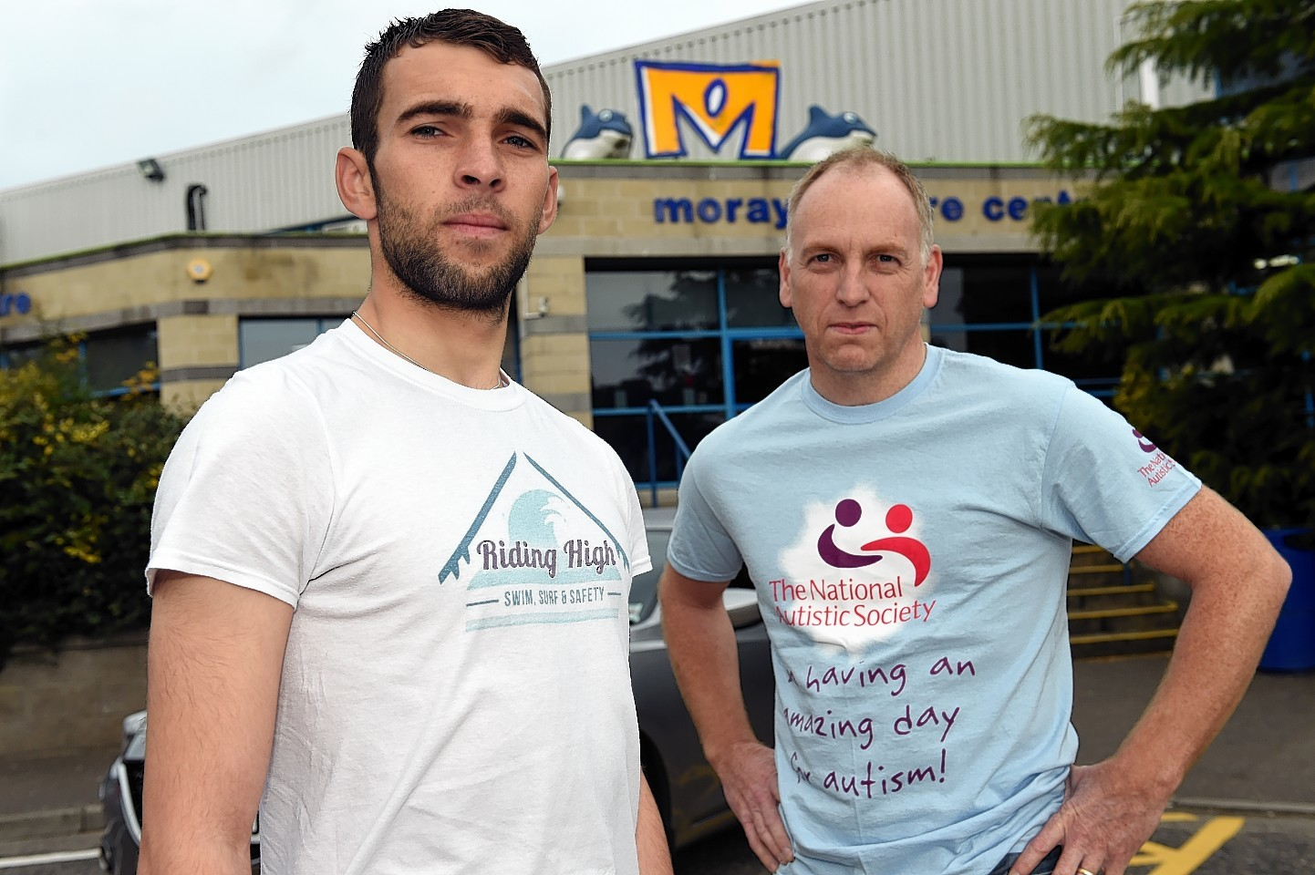 Kev Anderson, left, with Glyn Morris, chairman of the National Autistic Society outside the Moray Leisure Centre in Elgin