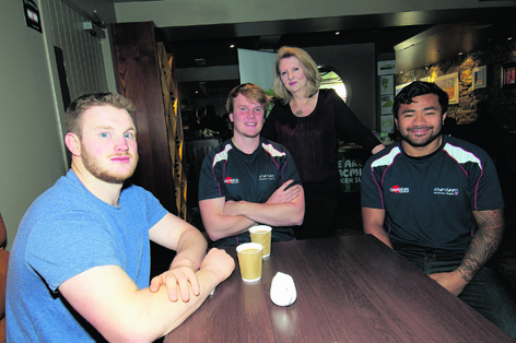 Muriel Roberts with Aberdeen Grammar rugby players Tony McGinness, Stuart Smith and John Poe