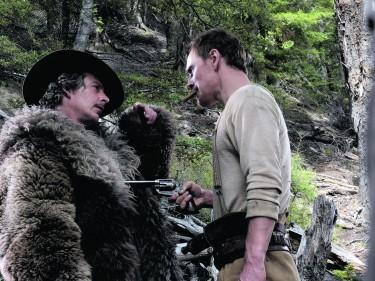 Ben Mendelsohn, left, and Michael Fassbender in Slow West