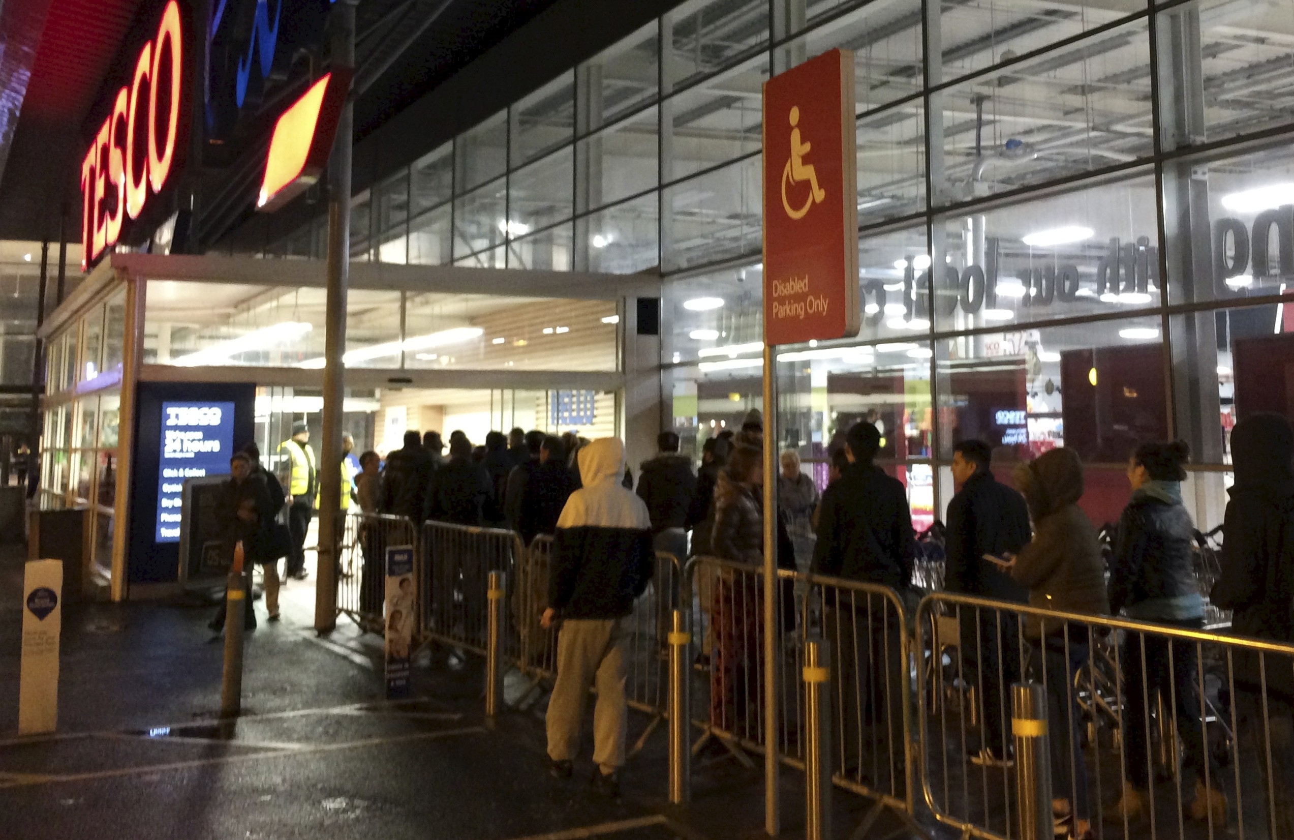 People shop for discount items at the Tesco Extra in Siverburn, Glasgow, during the black Friday sales.