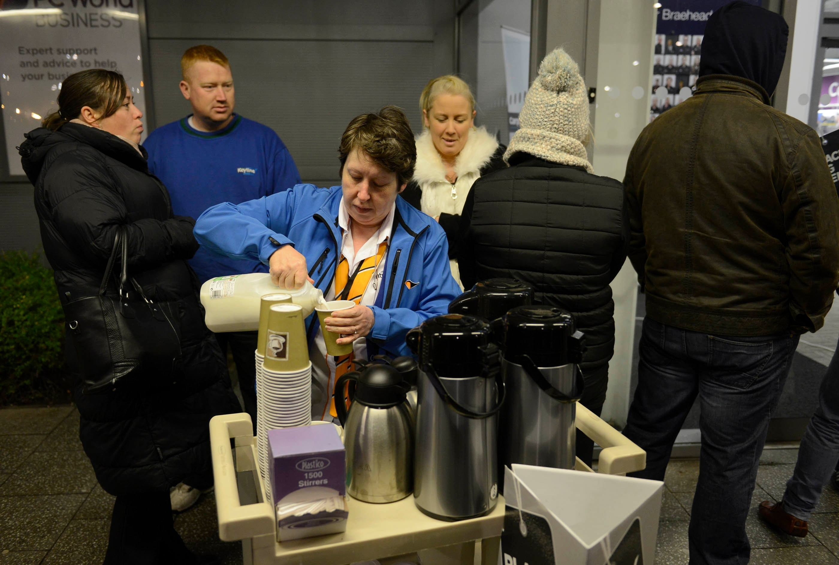 Small numbers of early morning shoppers get coffee as they get ready to enter Currys PC World, intu Braehead, Glasgow, at 6am for Black Friday sales, November 27, 2015. Large crowds did not materialise despite the bargains.