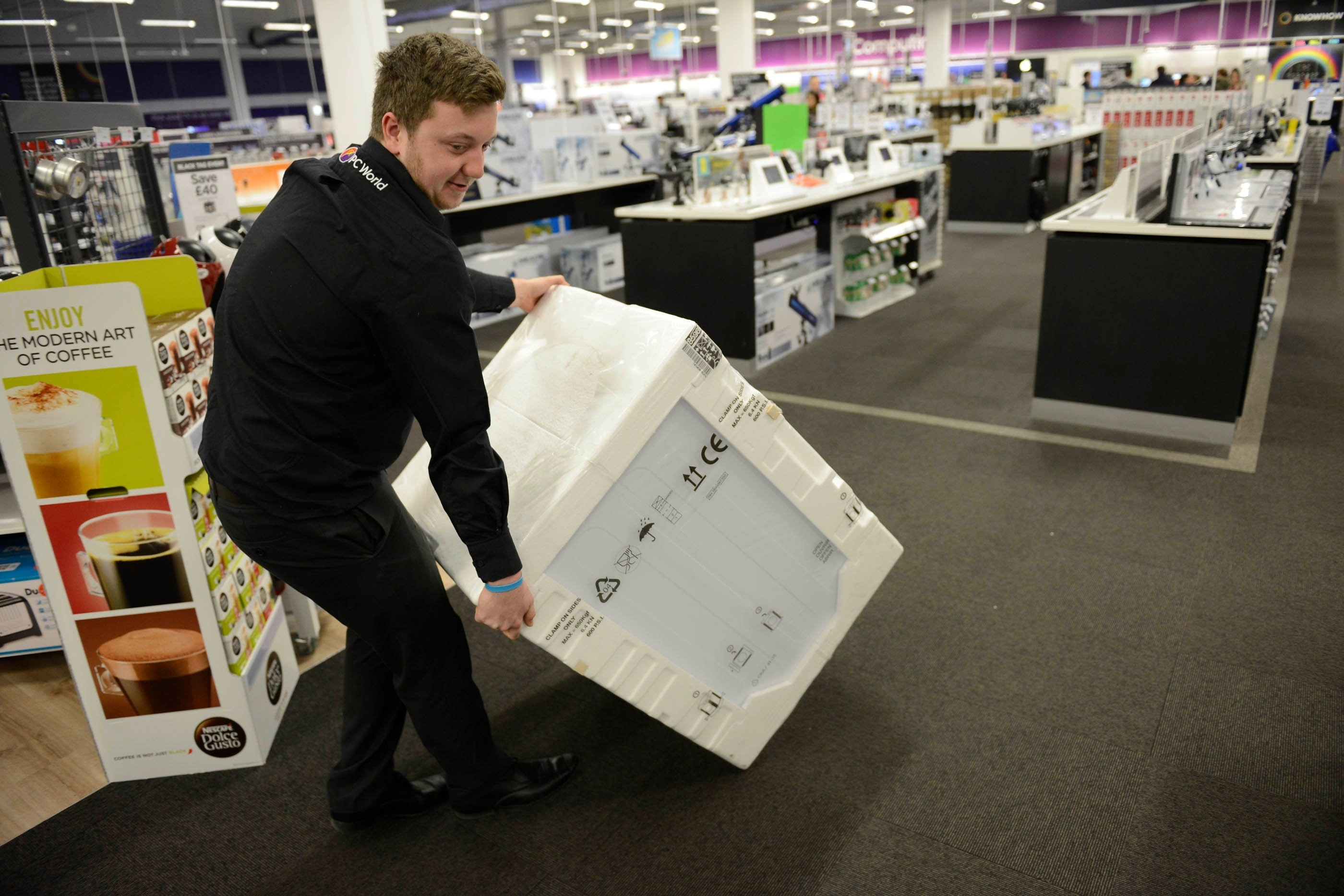 Staff member moves a dryer at Currys PC World, intu Braehead, Glasgow, for Black Friday sales, November 27, 2015. Large crowds did not materialise despite the bargains on offer with very few shoppers being in the store shortly after opening at 6am.